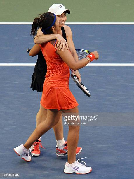 Cara Black of Zimbabwe and Sania Mirza of India celebrate after winning their women's doubles final match against HaoChing Chan of Chinese Taipei and...