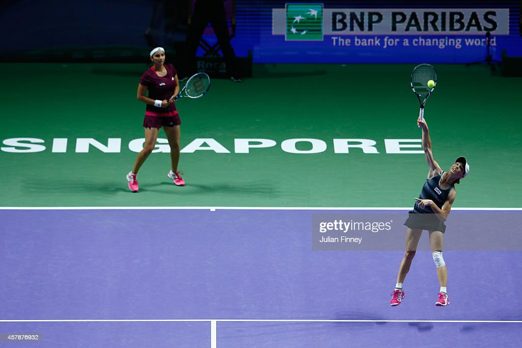 Cara Black of Zimbabwe and Sania Mirza of India in action against Su-Wei Hsieh of Taipei and Shuai Peng of China in the doubles final during day seven of the BNP Paribas WTA Finals tennis at the Singapore Sports Hub on October 26, 2014 in Singapore.