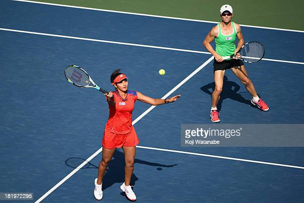 Cara Black of Zimbabwe and Sania Mirza of India in action during their match against Suwei Hsieh of Chinese Taipei and Shuai Peng of China in the...