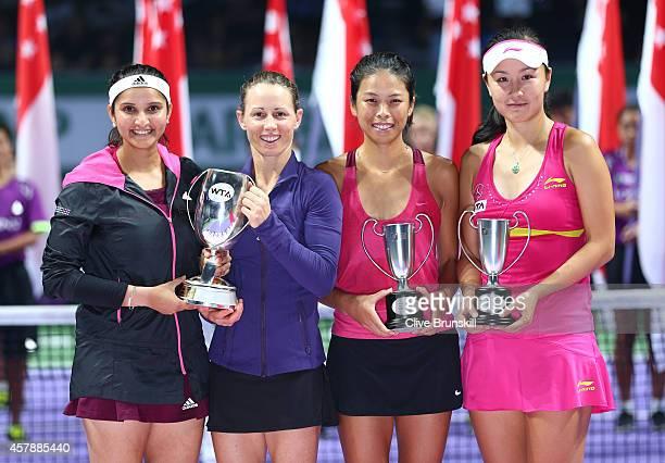 Cara Black of Zimbabwe and Sania Mirza of India pose for a photograph with Martina Navratilova and the Martina Navratilova Trophy after their...