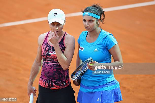 Cara Black of Zimbabwe and Sania Mirza of India talk tactics in their doubles match against Martina Hingis of Switzerland and Sabine Lisicki of...