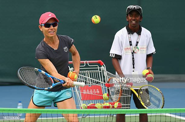 Cara Black of Zimbabwe helps with a disabled coaching clinic during day three of the WTA Dubai Duty Free Tennis Championship on February 20, 2013 in...