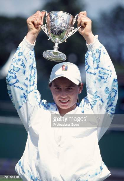 Cara Black of Zimbabwe lifts the trophy after defeating Brie Rippner of the USA in the Girls' Singles Final of the Wimbledon Lawn Tennis...