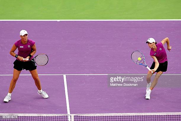 Cara Black of Zimbabwe returns a shot to Samantha Stosur and Rennae Stubbs while playing with Liezel Huber of the United States during the semifinals...