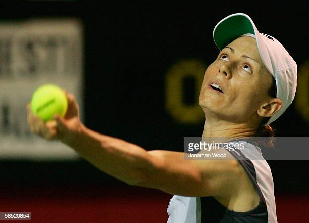 Cara Black of Zimbabwe serves during her doubles match against Maret Ani of Spain and Nicole Pratt of Australia during the WTA Mondial Australian...