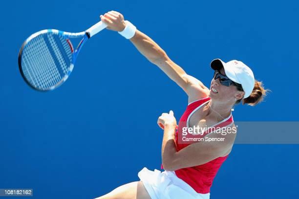 Cara Black of Zimbabwe serves in her first round doubles match with Anastasia Rodionova of Australia against Tamira Paszek of Austria and Tsvetana...