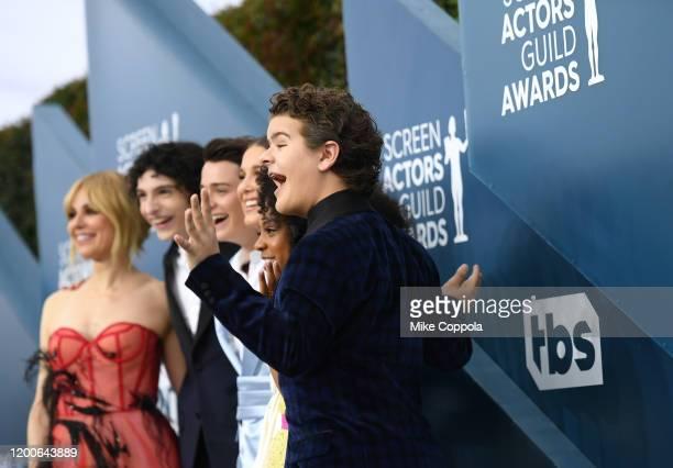 Cara Buono, Finn Wolfhard, Noah Schnapp, Millie Bobby Brown, Priah Ferguson, and Gaten Matarazzo attend the 26th Annual Screen ActorsGuild Awards at...