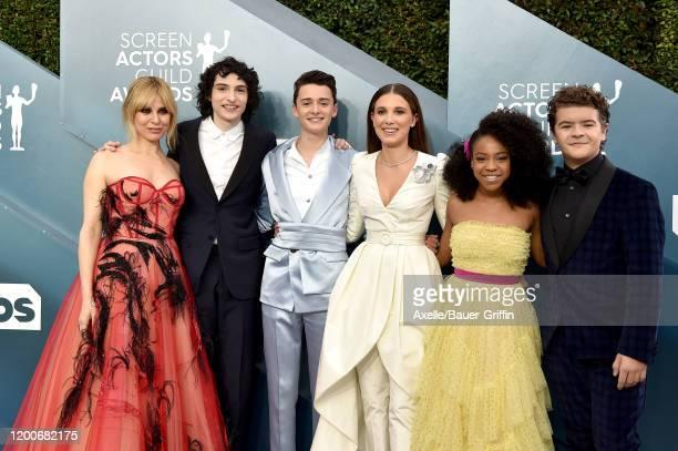 Cara Buono, Finn Wolfhard, Noah Schnapp, Millie Bobby Brown, Priah Ferguson, and Gaten Matarazzo attend the 26th Annual Screen Actors Guild Awards at...