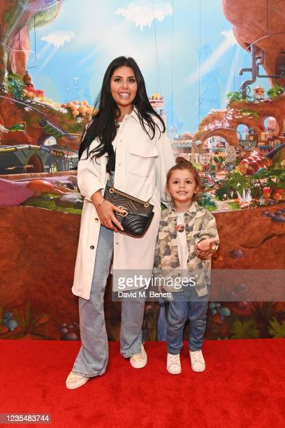 """Cara De La Hoyde-Massey and son Freddy attend the red carpet premiere of new animated children's series """"Moley"""" at Odeon Luxe Leicester Square on..."""