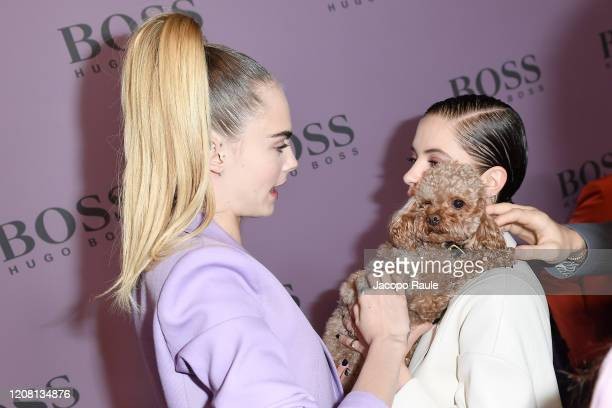 Cara Delevigne and Ashley Benson with Orlando Bloom's dog Mighty attend the Boss fashion show on February 23, 2020 in Milan, Italy.