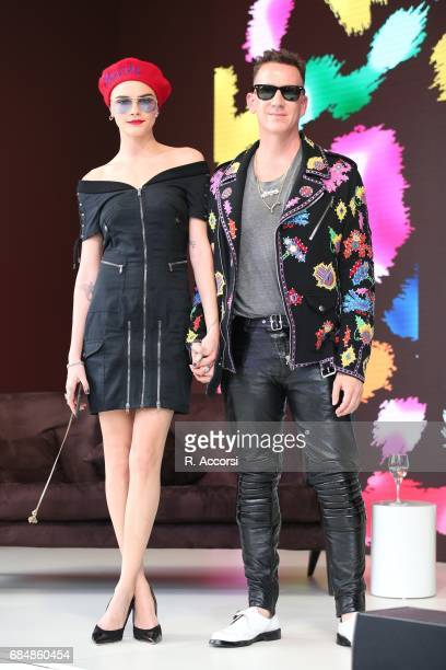 Cara Delevigne and Jeremy Scott attend Magnum photocall during the 70th annual Cannes Film Festival at Magnum Beach on May 18 2017 in Cannes France