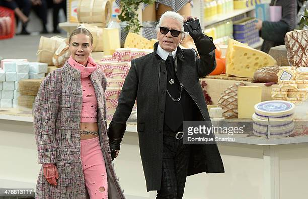Cara Delevigne and Karl Lagerfeld walk the runway during the Chanel show as part of the Paris Fashion Week Womenswear Fall/Winter 20142015 on March 4...