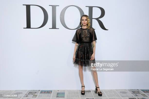 Cara Delevigne attends the Dior show as part of the Paris Fashion Week Womenswear Fall/Winter 2020/2021 on February 25, 2020 in Paris, France.