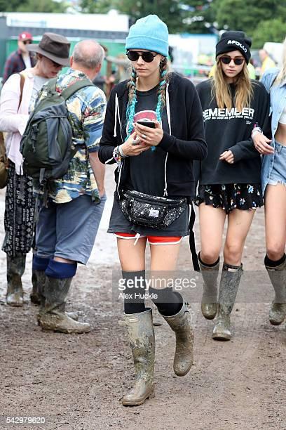 Cara Delevigne attends the Glastonbury Festival at Worthy Farm Pilton on June 25 2016 in Glastonbury England
