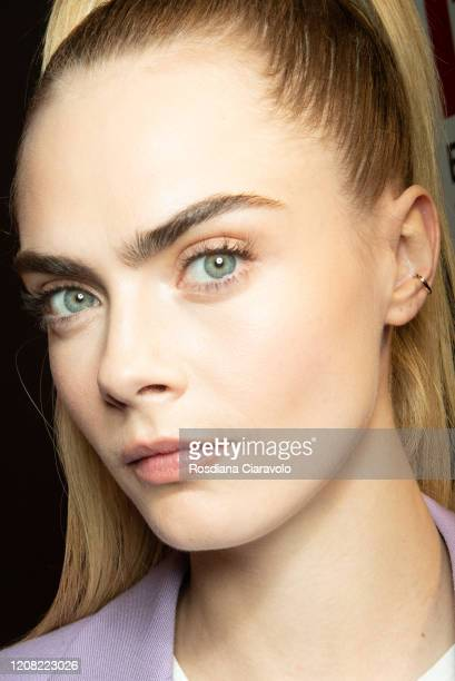 Cara Delevigne is seen backstage at the Boss fashion show on February 23, 2020 in Milan, Italy.