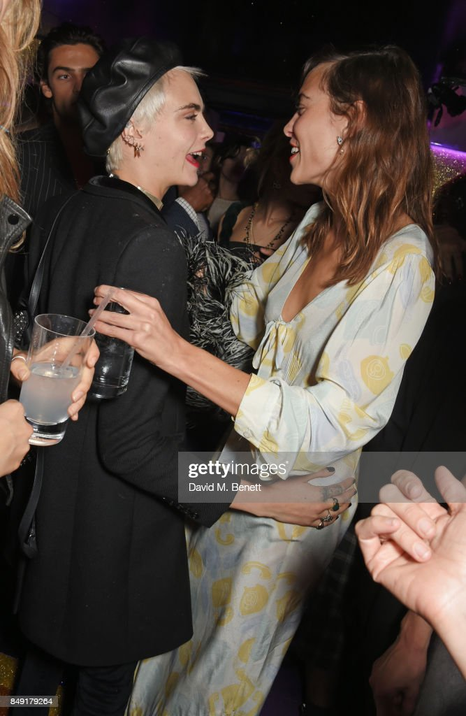 Cara Delevingne (L) and Alexa Chung attend the LOVE magazine x Miu Miu party, held during London Fashion Week, at Loulou's on September 18, 2017 in London, England.