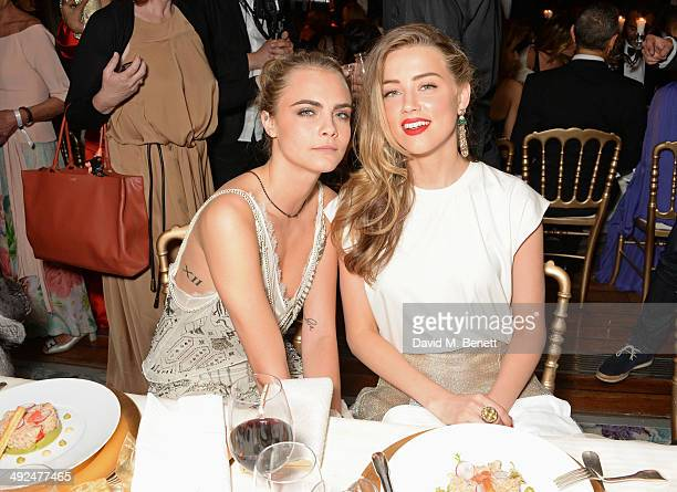 Cara Delevingne and Amber Heard attend the de Grisogono 'Fatale In Cannes' party during the 67th Cannes Film Festival at Hotel du Cap-Eden-Roc on May...