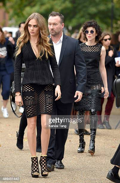 Cara Delevingne and Annie Clark attend the Burberry Prorsum show during London Fashion Week Spring/Summer 2016/17 at Kensington Gardens on September...
