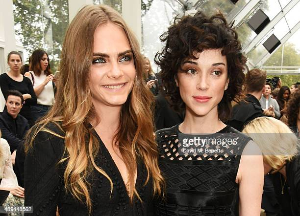 Cara Delevingne and Annie Clark attend the Burberry Womenswear Spring/Summer 2016 show during London Fashion Week at Kensington Gardens on September...