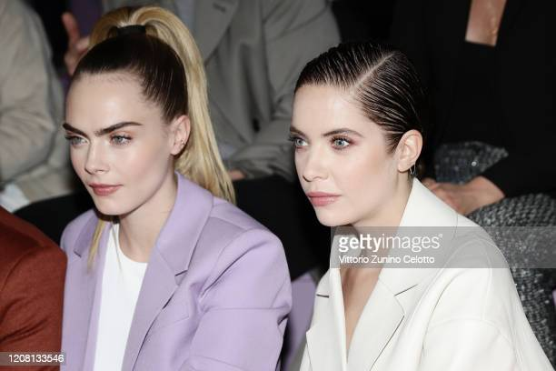 Cara Delevingne and Ashley Benson attend the BOSS fashion show during the Milan Fashion Week Fall/Winter 2020 2021 on February 23 2020 in Milan Italy