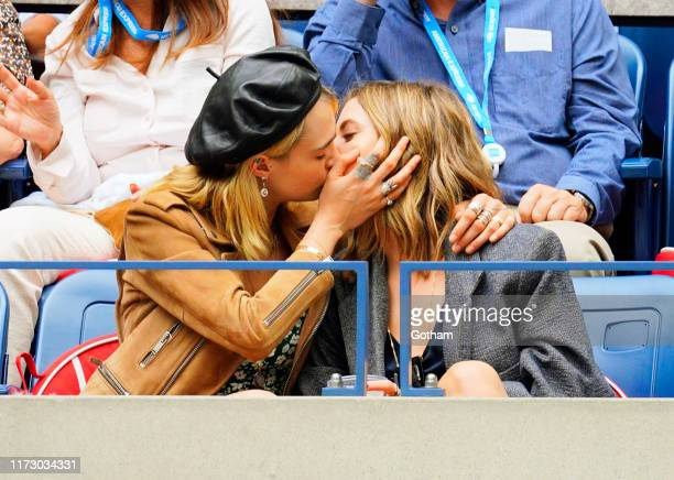 Cara Delevingne and Ashley Benson share a kiss during the 2019 US Open Women's final on September 07, 2019 in New York City.