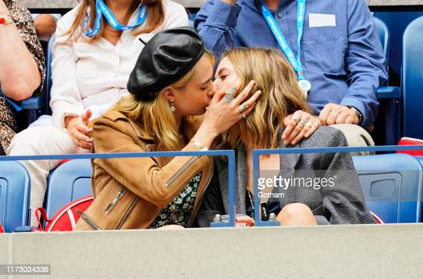 Cara Delevingne and Ashley Benson share a kiss during the 2019 US Open Women's final on September 07 2019 in New York City
