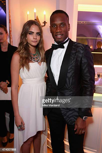 Cara Delevingne and Didier Drogba attend the De Grisogono Divine In Cannes Dinner Party at Hotel du CapEdenRoc on May 19 2015 in Cap d'Antibes France