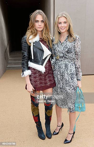 Cara Delevingne and Donna Air arrive at the Burberry Prorsum AW 2015 during London Fashion Week at Kensington Gardens on February 23 2015 in London...