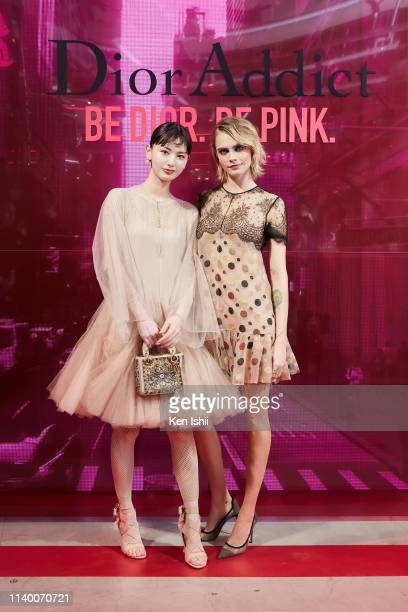 Cara Delevingne and Emi Suzuki pose for photographs during the Dior Addict Stellar Shine launch on April 2 2019 in Tokyo Japan