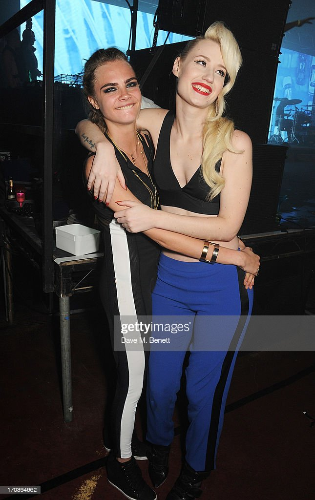 Cara Delevingne (L) and Iggy Azalea attend Club DKNY in celebration of #DKNYARTWORKS hosted by Cara Delevingne with special performances by Rita Ora and Iggy Azalea at The Fire Station on June 12, 2013 in London, England.
