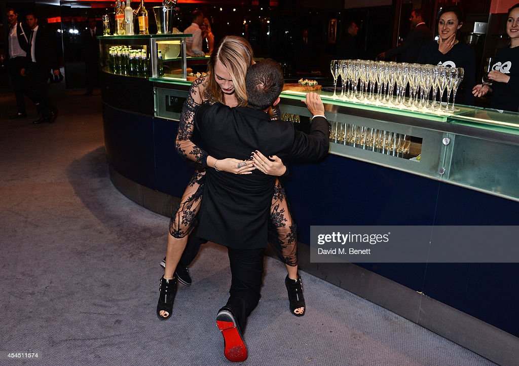 Cara Delevingne (L) and Jonathan Saunders attend the GQ Men Of The Year awards in association with Hugo Boss at The Royal Opera House on September 2, 2014 in London, England.