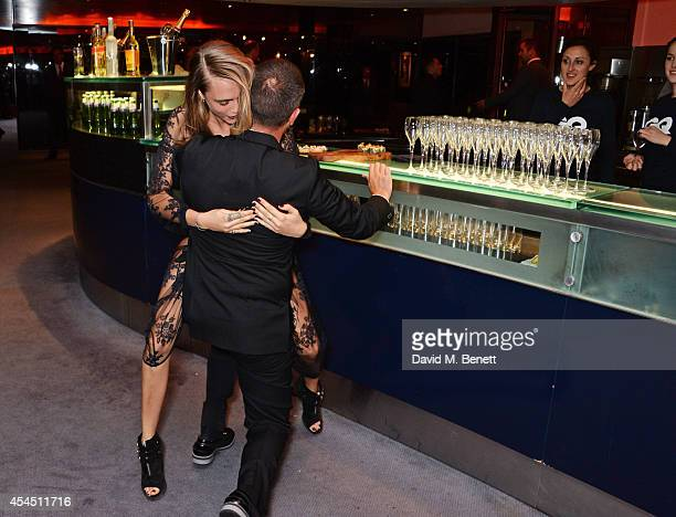 Cara Delevingne and Jonathan Saunders attend the GQ Men Of The Year awards in association with Hugo Boss at The Royal Opera House on September 2,...