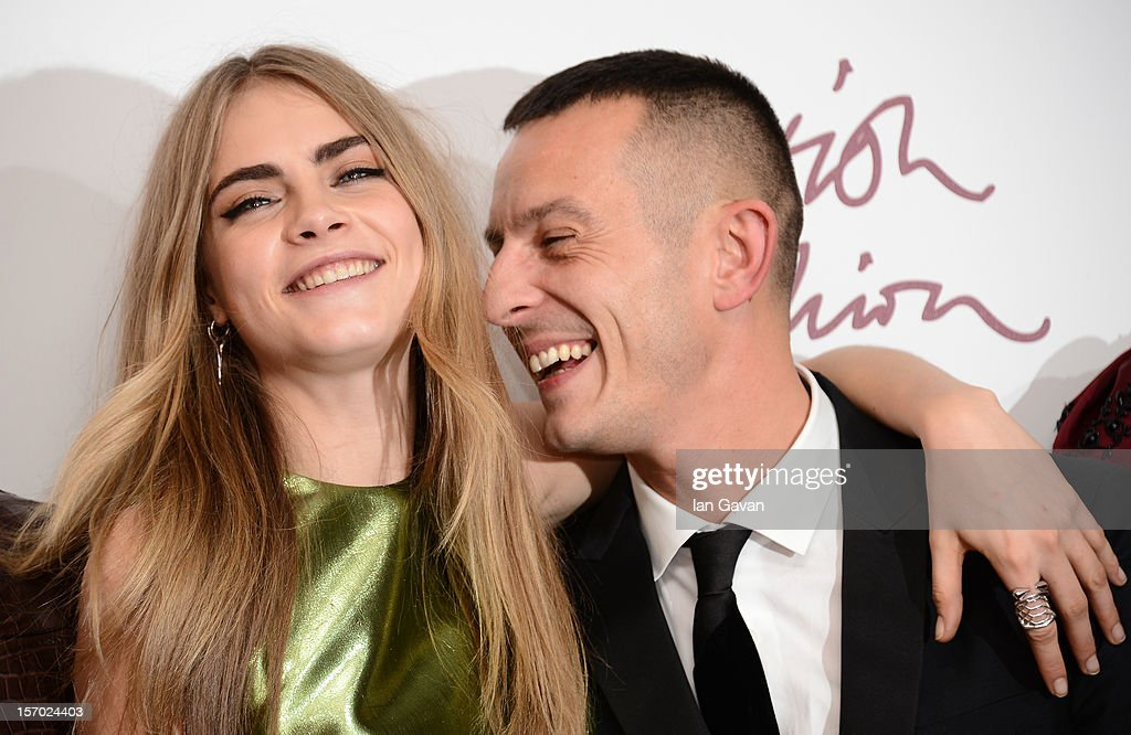 Cara Delevingne and Jonathan Saunders pose in the awards room at the British Fashion Awards 2012 at The Savoy Hotel on November 27, 2012 in London, England.