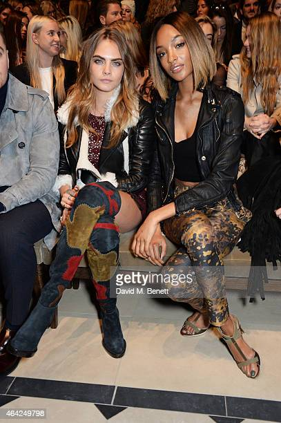 Cara Delevingne and Jourdan Dunn attend the Burberry Prorsum AW 2015 show during London Fashion Week at Kensington Gardens on February 23, 2015 in...