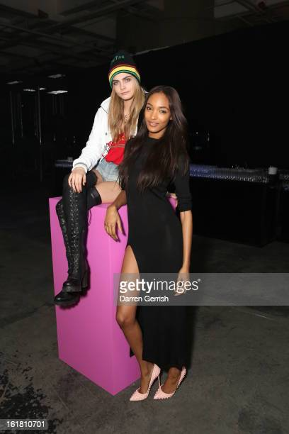 Cara Delevingne and Jourdan Dunn attend the Rihanna for River Island show during London Fashion Week Fall/Winter 2013/14 at The Old Sorting Office on...