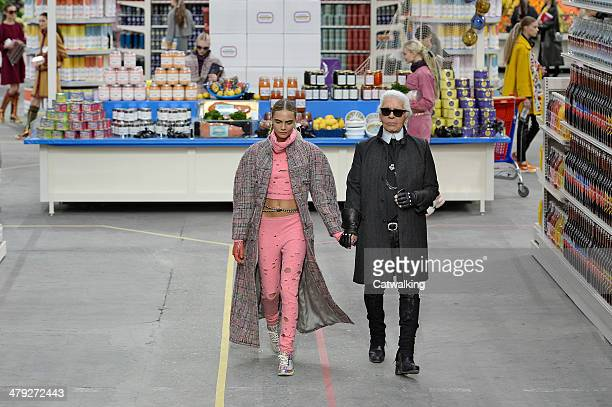Cara Delevingne and Karl Lagerfeld and walk the runway at the Chanel Autumn Winter 2014 fashion show during Paris Fashion Week on March 4 2014 in...