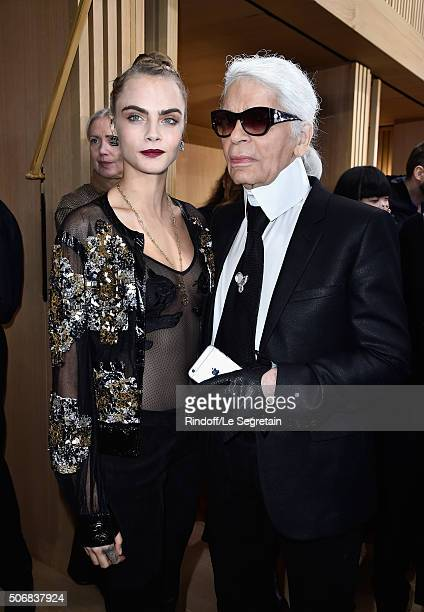 Cara Delevingne and Karl Lagerfeld attend the Chanel Spring Summer 2016 show as part of Paris Fashion Week on January 26 2016 in Paris France