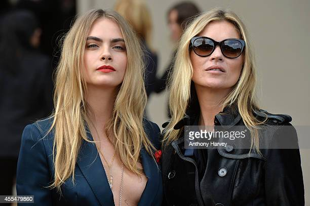 Cara Delevingne and Kate Moss attend the Burberry Prorsum show Womens wear 2015 during the London Fashion Week SS15 on September 15 2014 in London...