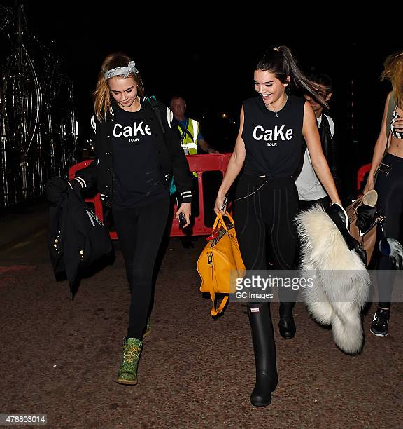 Cara Delevingne and Kendall Jenner leave Hyde Park after watching Taylor Swift and Ellie Goulding perform on June 27, 2015 in London, England.
