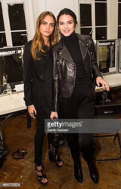 Cara Delevingne and Kendall Jenner pose backstage at the GILES show during London Fashion Week Fall/Winter 2015/16 at Central Saint Martins on...