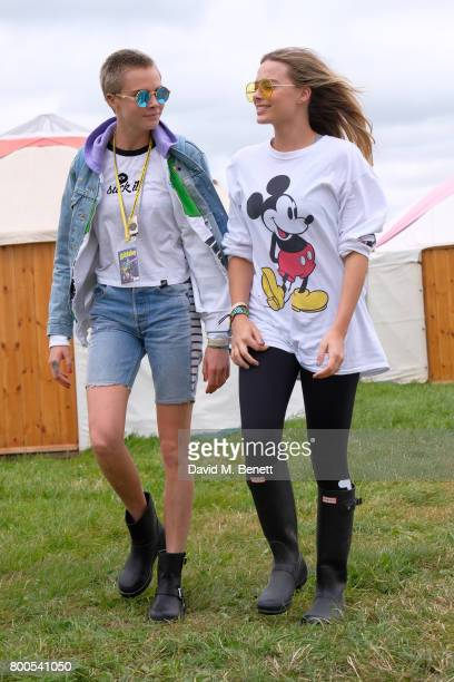 Cara Delevingne and Margot Robbie attend day two of Glastonbury on June 24 2017 in Glastonbury England