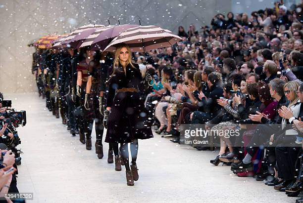 Cara Delevingne and models walk the runway during the Burberry Prorsum show at London Fashion Week Autumn/Winter 2012 at Kensington Gardens on...