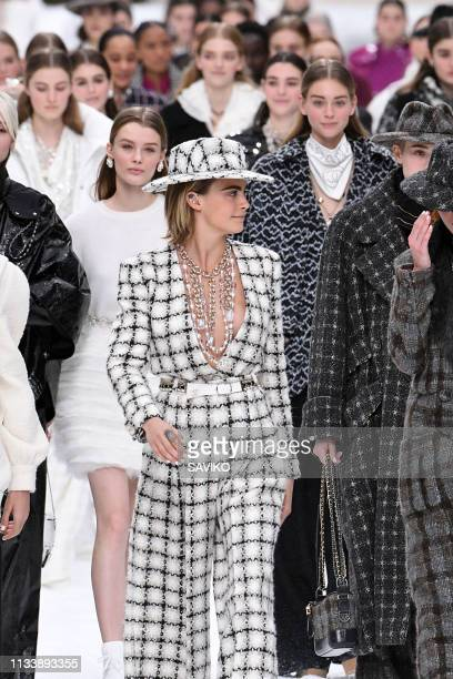 be4ad15f9be Cara Delevingne and models walk the runway during the Chanel Ready to Wear  fashion show as