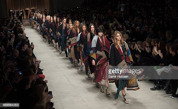 Cara Delevingne and models walk the runway with models at the Burberry Prorsum show at Perks Field during London Fashion Week AW14 in at the...