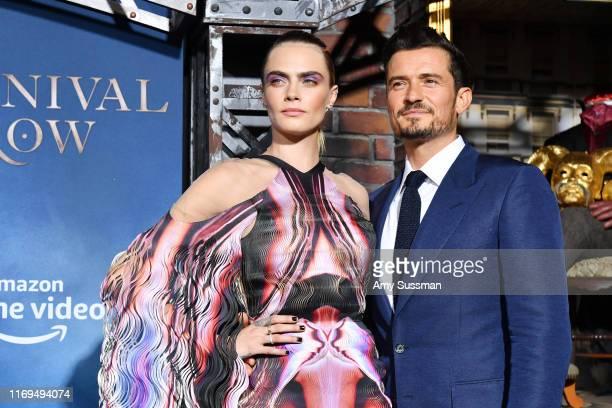 Cara Delevingne and Orlando Bloom arrive at the LA Premiere Of Amazon's Carnival Row at TCL Chinese Theatre on August 21 2019 in Hollywood California
