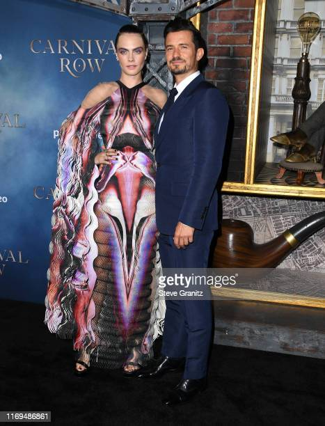 Cara Delevingne and Orlando Bloom arrives at the LA Premiere Of Amazon's Carnival Row at TCL Chinese Theatre on August 21 2019 in Hollywood California