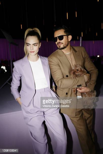 Cara Delevingne and Orlando Bloom attend the BOSS fashion show during the Milan Fashion Week Fall/Winter 2020 - 2021 on February 23, 2020 in Milan,...