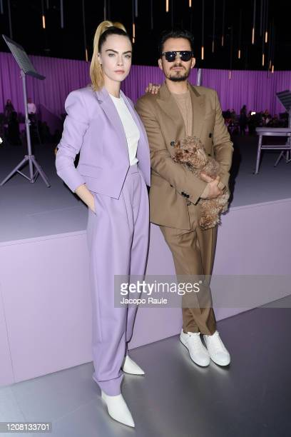 Cara Delevingne and Orlando Bloom with his dog Mighty attend the Boss fashion show on February 23 2020 in Milan Italy