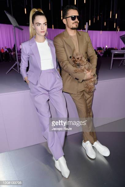 Cara Delevingne and Orlando Bloom with his dog Mighty attend the Boss fashion show on February 23, 2020 in Milan, Italy.
