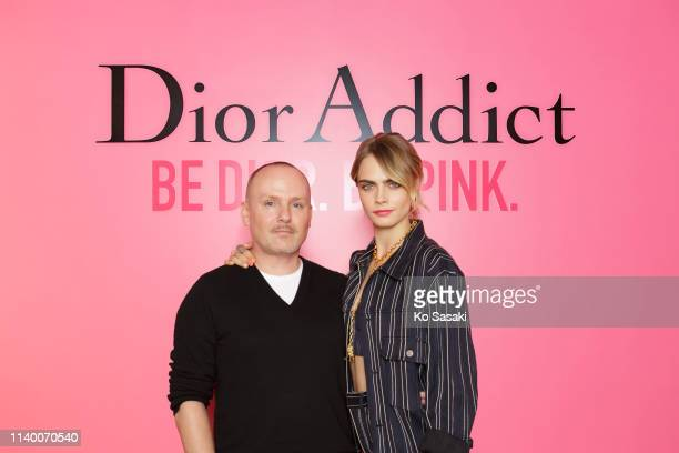 Cara Delevingne and Peter Philips pose for photographs during the Dior Addict Stellar Shine launch on April 2 2019 in Tokyo Japan